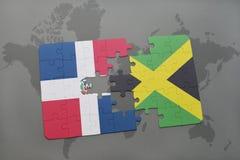 ο γρίφος με τη εθνική σημαία της Δομινικανής Δημοκρατίας και η Τζαμάικα σε έναν κόσμο χαρτογραφούν το υπόβαθρο Στοκ φωτογραφία με δικαίωμα ελεύθερης χρήσης