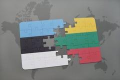 ο γρίφος με τη εθνική σημαία της Εσθονίας και η Λιθουανία σε έναν κόσμο χαρτογραφούν το υπόβαθρο Στοκ Εικόνα