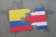 ο γρίφος με τη εθνική σημαία της Κολομβίας και η Κόστα Ρίκα σε έναν κόσμο χαρτογραφούν το υπόβαθρο Στοκ Φωτογραφίες
