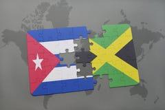 ο γρίφος με τη εθνική σημαία της Κούβας και η Τζαμάικα σε έναν κόσμο χαρτογραφούν το υπόβαθρο Στοκ Εικόνα