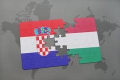 ο γρίφος με τη εθνική σημαία της Κροατίας και η Ουγγαρία σε έναν κόσμο χαρτογραφούν το υπόβαθρο Στοκ εικόνες με δικαίωμα ελεύθερης χρήσης