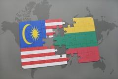 ο γρίφος με τη εθνική σημαία της Μαλαισίας και η Λιθουανία σε έναν κόσμο χαρτογραφούν το υπόβαθρο Στοκ Φωτογραφίες