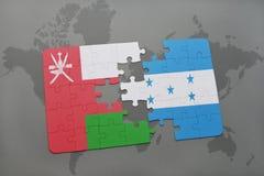 ο γρίφος με τη εθνική σημαία του Ομάν και η Ονδούρα σε έναν κόσμο χαρτογραφούν το υπόβαθρο Στοκ φωτογραφία με δικαίωμα ελεύθερης χρήσης
