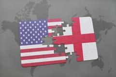 ο γρίφος με τη εθνική σημαία των Ηνωμένων Πολιτειών της Αμερικής και η Αγγλία σε έναν κόσμο χαρτογραφούν το υπόβαθρο Στοκ φωτογραφία με δικαίωμα ελεύθερης χρήσης