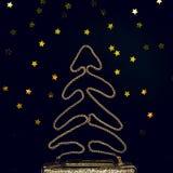 Ο εορταστικός χρυσός συμπλέκτης βραδιού με το αστέρι ψεκάζει στο Μαύρο Holi Στοκ Φωτογραφίες