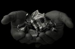 Ο επαίτης κρατά τα δολάρια Στοκ Εικόνα