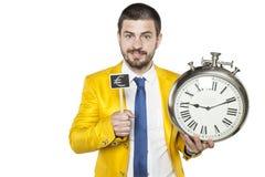 Ο επιχειρηματίας λέει ότι ο χρόνος είναι χρήματα Στοκ φωτογραφίες με δικαίωμα ελεύθερης χρήσης