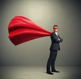 Ο επιχειρηματίας έντυσε ως superhero Στοκ εικόνα με δικαίωμα ελεύθερης χρήσης