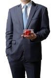 Ο επιχειρηματίας δίνει το πρότυπο αεροπλάνο στον πελάτη που απομονώνεται επάνω Στοκ εικόνες με δικαίωμα ελεύθερης χρήσης