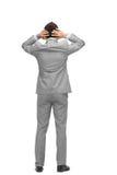 Ο επιχειρηματίας αρπάζει το κεφάλι του από την πλάτη Στοκ Φωτογραφίες