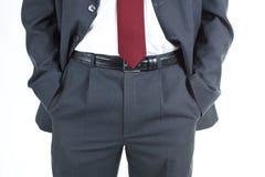 ο επιχειρηματίας δίνει κοντά την τσέπη του s επάνω Στοκ Εικόνες