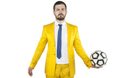 Ο επιχειρηματίας επενδύει στη σφαίρα ποδοσφαίρου Στοκ φωτογραφία με δικαίωμα ελεύθερης χρήσης