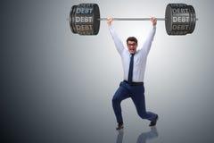 Ο επιχειρηματίας κάτω από το βαρύ φορτίο του χρέους Στοκ εικόνα με δικαίωμα ελεύθερης χρήσης