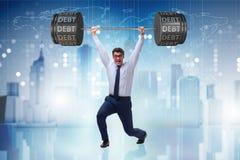 Ο επιχειρηματίας κάτω από το βαρύ φορτίο του χρέους Στοκ εικόνες με δικαίωμα ελεύθερης χρήσης