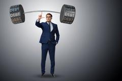Ο επιχειρηματίας κάτω από το βαρύ φορτίο του χρέους Στοκ φωτογραφία με δικαίωμα ελεύθερης χρήσης