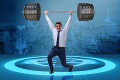 Ο επιχειρηματίας κάτω από το βαρύ φορτίο του χρέους Στοκ Εικόνες