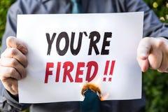 Ο επιχειρηματίας κρατά ένα καίγοντας έγγραφο με το κείμενο Στοκ Φωτογραφίες