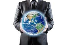 Ο επιχειρηματίας κρατά τη γη Στοκ Εικόνα