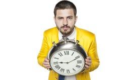 Ο επιχειρηματίας κρατά το χρόνο στα χέρια του Στοκ Φωτογραφία