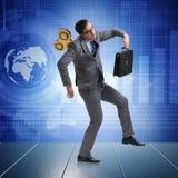 Ο επιχειρηματίας με το κλειδί στην εργατική έννοια Στοκ Φωτογραφίες
