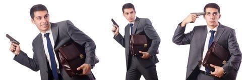 Ο επιχειρηματίας με το πυροβόλο όπλο που απομονώνεται στο λευκό Στοκ φωτογραφία με δικαίωμα ελεύθερης χρήσης
