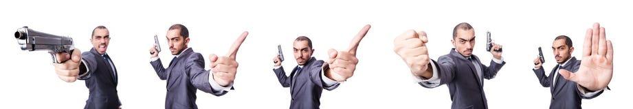 Ο επιχειρηματίας με το πυροβόλο όπλο που απομονώνεται στο λευκό Στοκ Εικόνες