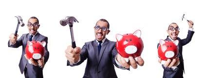 Ο επιχειρηματίας με το piggybank στο λευκό Στοκ Εικόνες