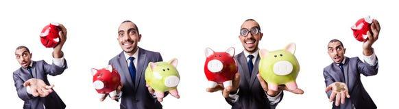 Ο επιχειρηματίας με το piggybank στο λευκό Στοκ εικόνες με δικαίωμα ελεύθερης χρήσης