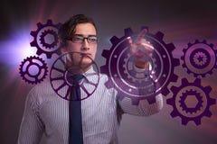 Ο επιχειρηματίας με cogwheels συνδέει στην έννοια ομαδικής εργασίας Στοκ φωτογραφίες με δικαίωμα ελεύθερης χρήσης