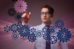 Ο επιχειρηματίας με cogwheels συνδέει στην έννοια ομαδικής εργασίας Στοκ εικόνες με δικαίωμα ελεύθερης χρήσης