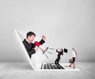 Ο επιχειρηματίας με megaphone παίρνει από το lap-top Στοκ εικόνα με δικαίωμα ελεύθερης χρήσης