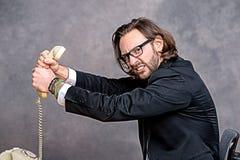 Ο 0 επιχειρηματίας πνίγει το τηλέφωνό του Στοκ Εικόνες