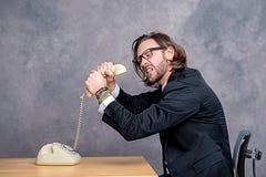 Ο 0 επιχειρηματίας πνίγει το τηλέφωνό του Στοκ Φωτογραφίες