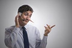 Ο επιχειρηματίας στο τηλέφωνο που βρίσκεται στον αντίπαλό του Στοκ Εικόνες