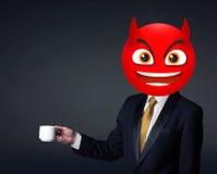 Ο επιχειρηματίας φορά το πρόσωπο smiley διαβόλων Στοκ εικόνα με δικαίωμα ελεύθερης χρήσης