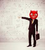 Ο επιχειρηματίας φορά το πρόσωπο smiley διαβόλων Στοκ Εικόνα