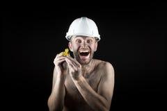 Ο ευτυχής ανθρακωρύχος παρουσιάζει χρυσό ψήγμα Στοκ Φωτογραφίες