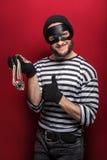 Ο ευτυχής κλέφτης έκλεψε το περιδέραιο Στοκ φωτογραφίες με δικαίωμα ελεύθερης χρήσης