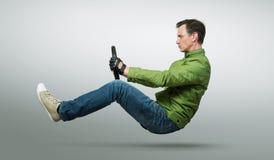 Οδηγός αυτοκινήτων ατόμων με μια ρόδα Στοκ φωτογραφία με δικαίωμα ελεύθερης χρήσης