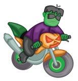 Οδηγώντας ποδήλατο φαναριών κολοκύθας Frankenstein Στοκ Εικόνα