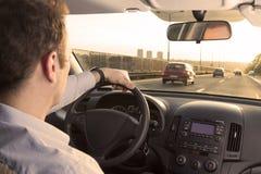 Οδηγώντας σπίτι μετά από την εργασία Στοκ Εικόνες