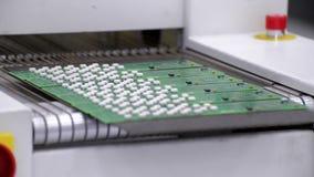 Ο ηλεκτρονικός τυπωμένος πίνακας κυκλωμάτων εισάγει το φούρνο επανακυκλοφορίας μεταφοράς αέρα απόθεμα βίντεο