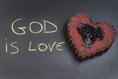 Ο Θεός είναι επιγραφή αγάπης στοκ εικόνες