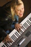 ο θηλυκός μουσικός εκτ& Στοκ Εικόνα