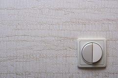 Ο διακόπτης τοίχων στο κατώτατο δικαίωμα Στοκ Φωτογραφίες