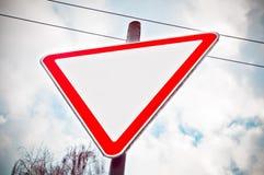 Οδικό σημάδι προειδοποίησης στο κόκκινο τρίγωνο στοκ φωτογραφίες
