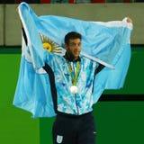 Ο κάτοχος αργυρού μεταλλίου Juan Martin Del Potro της Αργεντινής κατά τη διάρκεια των ατόμων ` s αντισφαίρισης ξεχωρίζει την τελε στοκ φωτογραφία με δικαίωμα ελεύθερης χρήσης