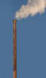 Ο καπνός προέρχεται από έναν σωλήνα Στοκ Φωτογραφία