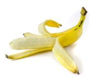 ο καρπός μπανανών ανασκόπησης απομόνωσε άσπρο κίτρινο φλούδας Στοκ Φωτογραφία