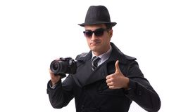 Ο κατάσκοπος με τη κάμερα που παίρνει τις εικόνες που απομονώνονται στο λευκό Στοκ Εικόνες